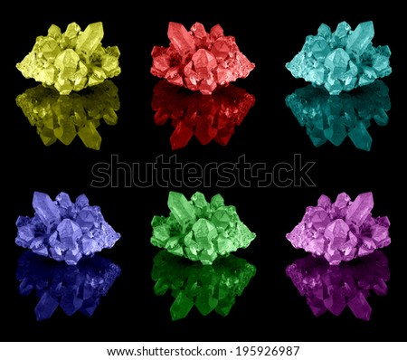 A collection of well developed and brightly colored limonite quartz crystal clusters with their reflection. - stock photo