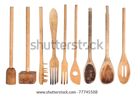 A collection of wooden kitchen utensils isolated on white - stock photo
