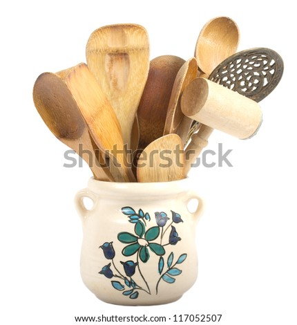 a collection of wooden kitchen utensils isolated on white background - stock photo