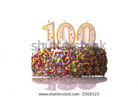 A colorful birthday cake with candles shaped like the number 100. White background. - stock photo
