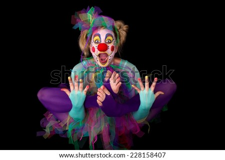A colorful clown is floating in the air - stock photo