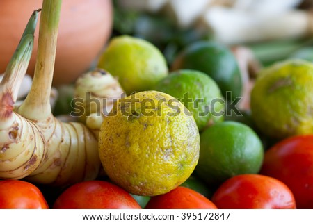 A colorful color of an ingredient for Tom Yum, Thai Food, include of lemon,galanga,tomatoes and lemongrass, a very popular thai dish for foreigner with hot and spicy taste eat with plain rice  - stock photo