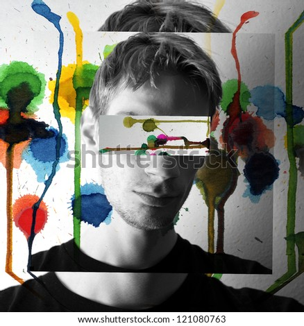 A colorful concept image of a guy with lots of water colors splashing and melting down on the walls around him. - stock photo