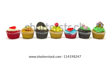 A colorful cupcakes on white background - stock photo