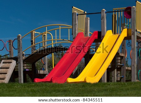 A colorful display of playground slides - stock photo