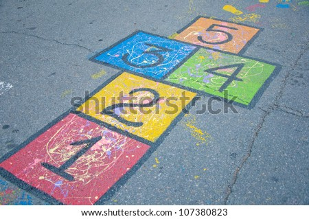 A colorful hopscotch game painted on the ground - stock photo