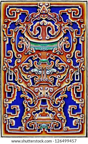A colorful medieval tribal pattern wall carving for textural background. - stock photo