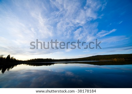 a colorful sunrise over a nordic river - stock photo