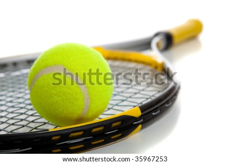 A colorful tennis ball and racket on a white background with copy space - stock photo