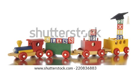 """A colorful toy train carrying alphabet blocks that spell out the words """"class of 2014.""""  On a white background. - stock photo"""