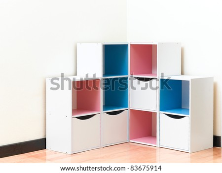 A colorful wooden cabinet with drawer - stock photo