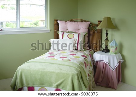 A colorful young girls bedroom. - stock photo