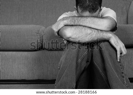 A colorless photo of a man suffering from clinical depression - stock photo