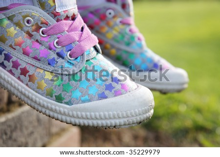 A colourful pair of girls casual shoes. - stock photo