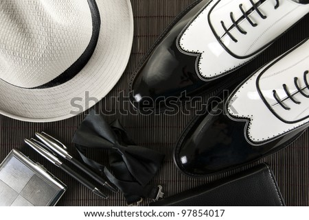 A combination of a man's accessories for an elegant evening, mafia shoes - stock photo