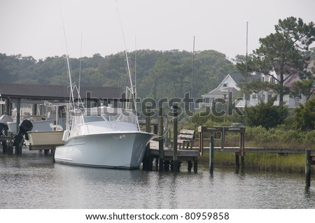 A commercial fishing boat docked at the ocean - stock photo