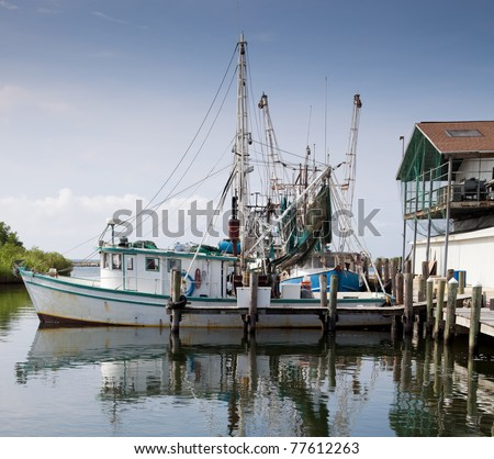 A commercial fishing boat in dock - stock photo