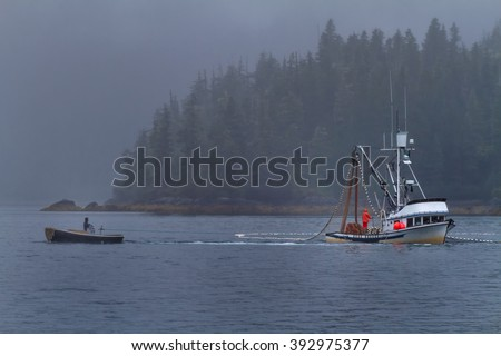 A commercial fishing boat seines for salmon in Prince William Sound near Valdez, Alaska - stock photo