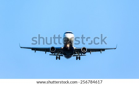A commercial jet preparing for landing. - stock photo