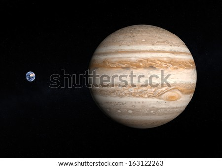 A comparison between the planets Earth and Jupiter on a slightly starry background. - stock photo