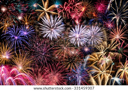 A  compilation or collage of different Fireworks bursting in the night sky, isolated on black background in high resolution - stock photo
