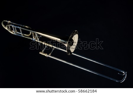A complete trombone Isolated against a black background in the Horizontal format. - stock photo
