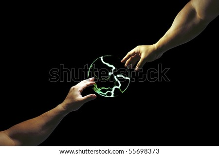 A composed image of two arm extending out to touch a ball of electric charge. - stock photo