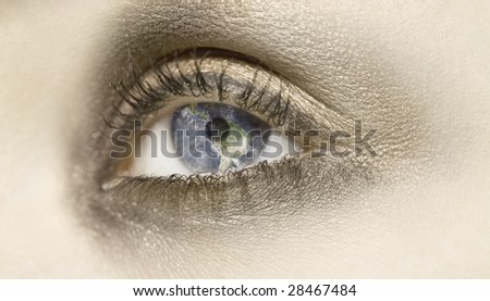 A composing with the earth in the eyes of a woman - stock photo