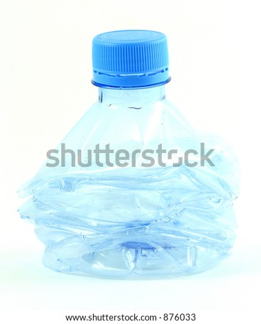 a compressed plastic water bottle - stock photo