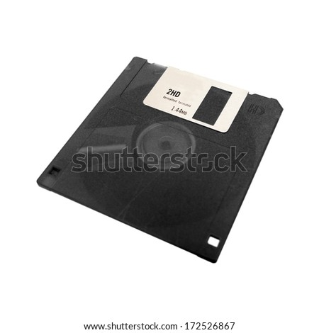 A computer floppy disk isolated on a white background - stock photo