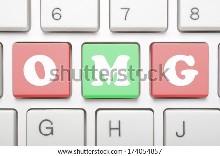 A computer keyboard with keys spelling OMG, Internet slang  - stock photo