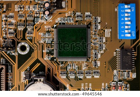 A computer motherboard chip view with DIP switches. - stock photo