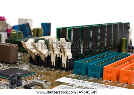 A computer motherboard with memory slots populated, macro close-up shot with low dof. - stock photo