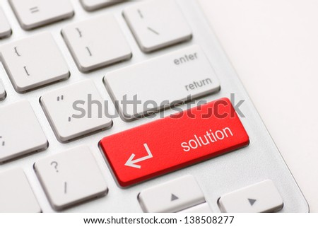 A computers solution key on white keyboard - stock photo