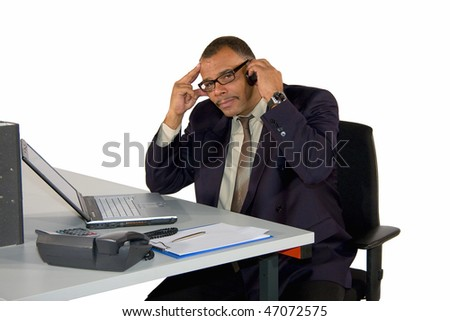 a concentrated mature African-American manager being busy phoning with his cell phone, isolated on white background - stock photo