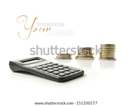 A concept image relating to financial matters. Stacked coins representing investments or savings with generic calculator.  Copy space. - stock photo
