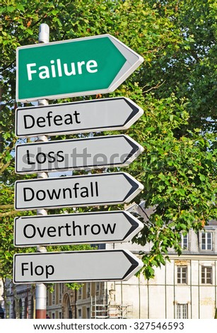A concept road sign pointing in the direction of 'Failure' with some descriptive words underneath - stock photo