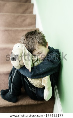 A Conceptual Image of an Abused Child suffering Domestic Violence.  - stock photo