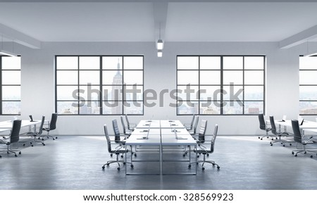 A conference room or corporate workplaces equipped by modern laptops in a modern panoramic office in New York. Black leather chairs and a white table. 3D rendering. - stock photo