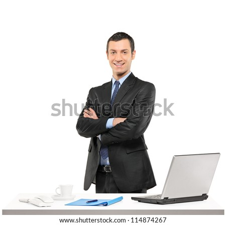 A confident businessman posing at his workplace isolated on white background - stock photo
