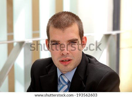 A confident businessman sitting in his office - stock photo