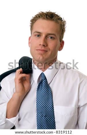 A confident businessman with his jacket over his shoulder - stock photo