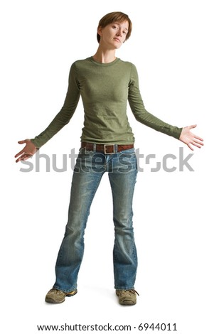 A confident young woman wearing blue jeans and a green shirt isolated against a white background. - stock photo