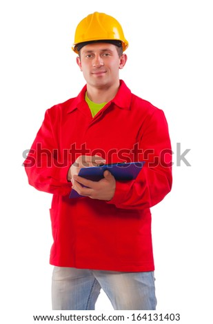 A construction supervisor writes on a clipboard. White background - stock photo