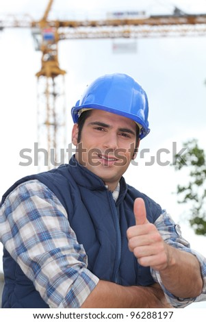 A construction worker giving the thumb up. - stock photo