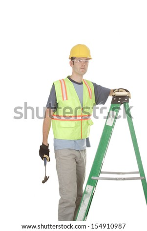 A construction worker in safety gear holds a hammer while standing on a ladder. Isolated on white. - stock photo