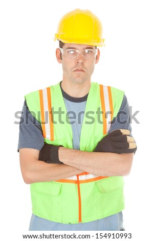 A construction worker looks serious with his arms crossed across his chest. Isolated on white. - stock photo