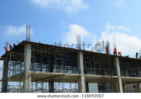 A construction worker on construction site - stock photo
