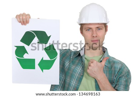 A construction worker promoting recycling. - stock photo