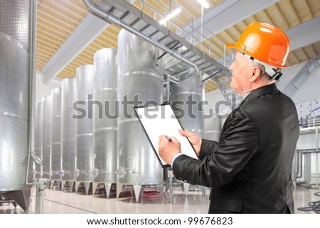 A construction worker with orange helmet at work place - stock photo